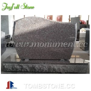upright pink granite tombstone