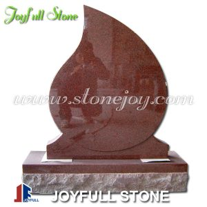 Red granite tear drop headstone